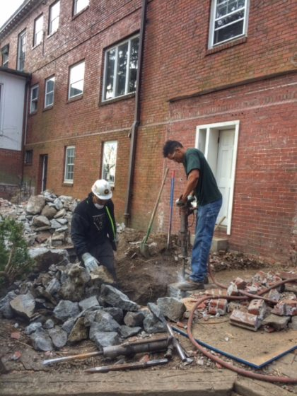 Concrete footing removal during the restoration of a 20th century colonial home on Providence's East Side.