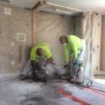 Sawcutting a plumbing trench for a new bathroom during a home renovation in Newport, RI.