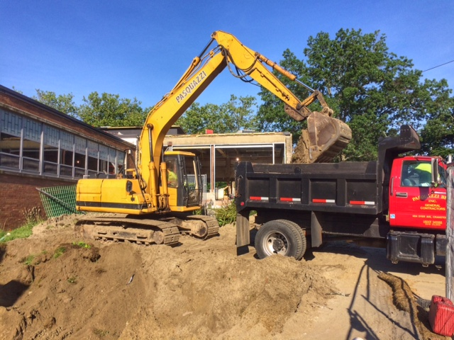 Excavating for a new ADA ramp at Eden Park Elementary School in Cranston, RI.