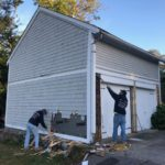 Siding removal during a garage renovation in East Greenwich, RI