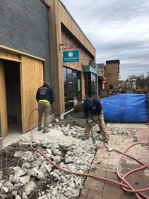 Concrete walkway removal during renovations to a unit in Garden City Shopping Center in Cranston, RI